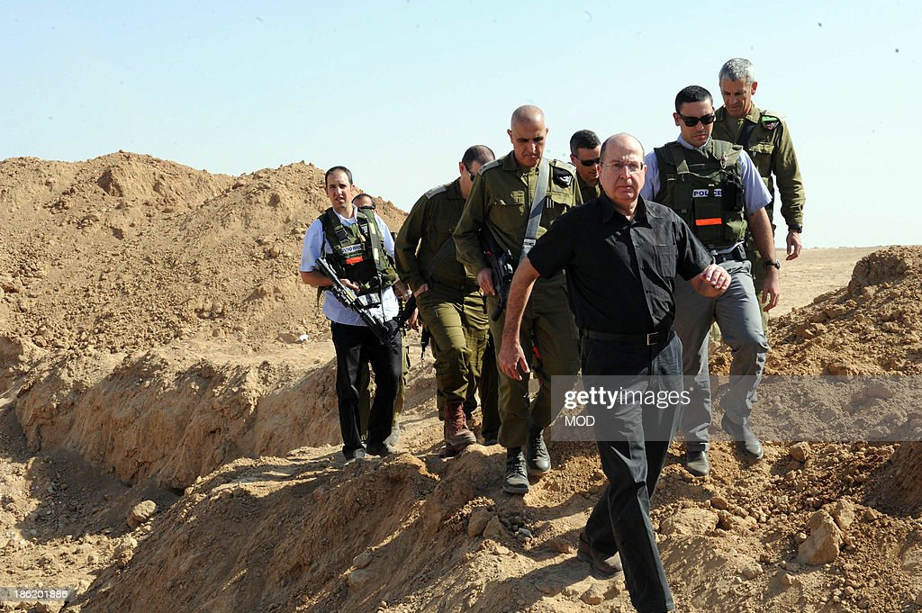 In this handout provided by the Israeli Ministry of Defense, Israeli Defense Minister Moshe Ya'alon (C) tours the Southern Command and the Gaza Division October 29, 2013 along the Israeli border with Gaza. Ya'alon reassured Israelis after the discovery of a tunnel linking Gaza to Israel that security on the southern border was strong.