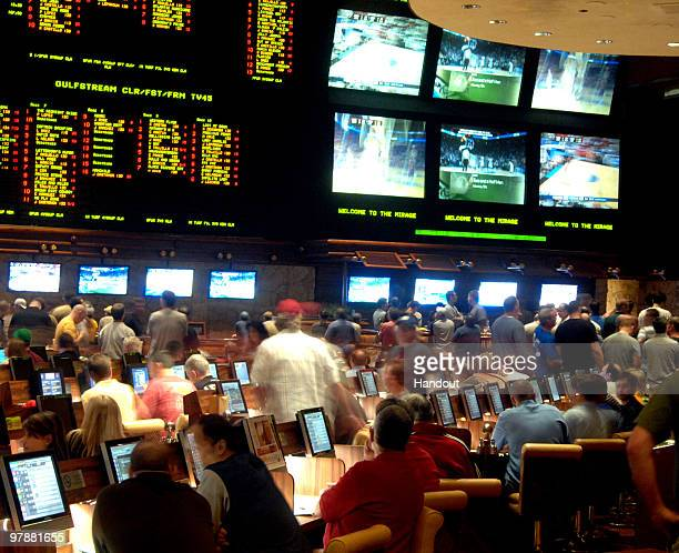 In this handout provided by the Las Vegas News Bureau the Mirage Resort Race and Sports Book in Las Vegas is shown crowded with basketball fans...