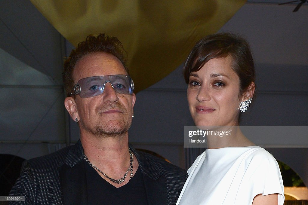In this handout provided by the Leonardo Dicaprio Foundation, (L-R) Bono and Marion Cotillard attend the Leonardo Dicaprio Foundation Launch at Domaine Bertaud Belieu on on July 23, 2014 in Saint-Tropez, France.