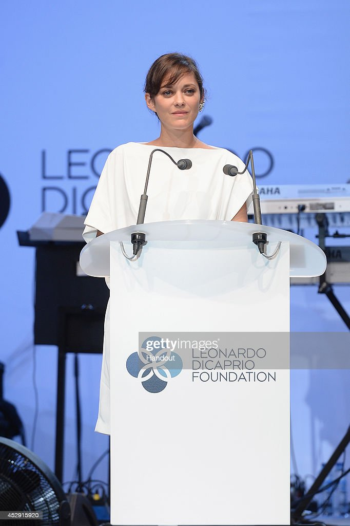 In this handout provided by the Leonardo Dicaprio Foundation, Marion Cotillard speaks on stage during the Leonardo Dicaprio Foundation Launch at Domaine Bertaud Belieu on July 23, 2014 in Saint-Tropez, France.