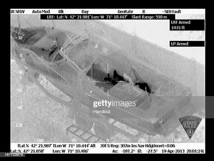 In this handout provided by the Massachusetts State Police, the boat in which Boston Marathon bombing suspect Dzhokhar A. Tsarnaev is hiding is seen from the Forward Looking Infrared setting of a police helicopter on Franklin Street on April 19, 2013 in Watertown, Massachusetts. A manhunt for Dzhokhar A. Tsarnaev, 19, a suspect in the Boston Marathon bombing ended after he was apprehended on a boat parked on a residential property. His brother Tamerlan Tsarnaev, 26, the other suspect, was shot and killed after a car chase and shootout with police. The bombing, on April 15 at the finish line of the marathon, killed three people and wounded at least 170