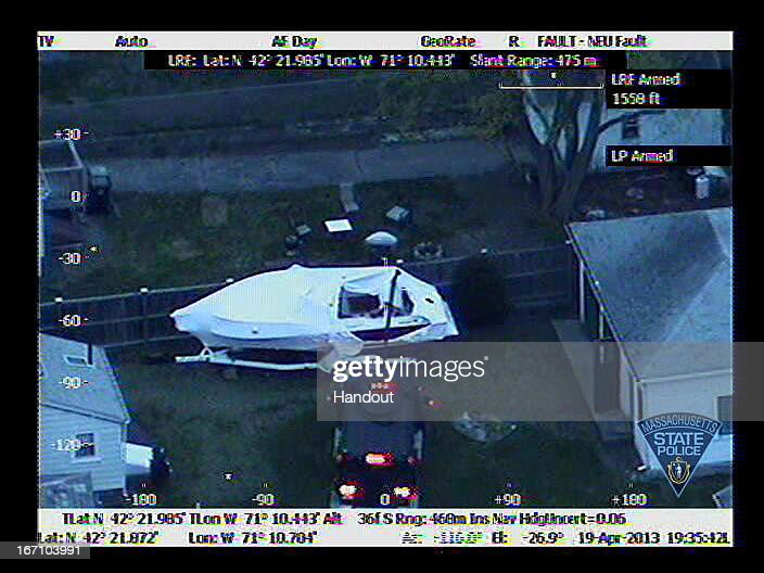 In this handout provided by the Massachusetts State Police, the boat in which Boston Marathon bombing suspect Dzhokhar A. Tsarnaev was hiding is seen from a police helicopter on Franklin Street on April 19, 2013 in Watertown, Massachusetts. A manhunt for Dzhokhar A. Tsarnaev, 19, a suspect in the Boston Marathon bombing ended after he was apprehended on a boat parked on a residential property. His brother Tamerlan Tsarnaev, 26, the other suspect, was shot and killed after a car chase and shootout with police. The bombing, on April 15 at the finish line of the marathon, killed three people and wounded at least 170