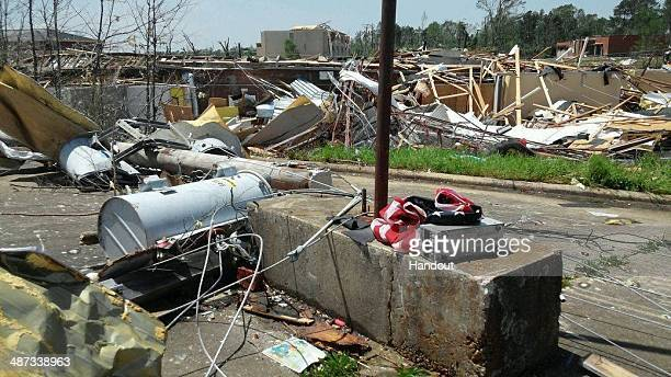 In this handout provided by the Mississippi National Guard an American flag lays amongst the rubble of a community following a deadly tornado April...