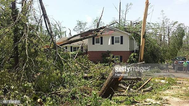 In this handout provided by the Mississippi National Guard Mississippi National Guard members respond in a community following a deadly tornado April...