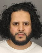 In this handout provided by the Monroe County Sheriff's Office Mufid Elfgeeh poses for a mug shot photo on September 16 2014 in Rochester New York...