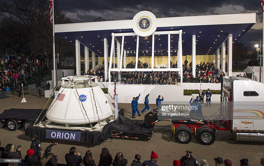 In this handout provided by the National Aeronautic and Space Administration (NASA), the Orion space capsule, along with NASA astronauts Lee Morin, Alvin Drew, Kjell Lindgren, Serena Aunon, Kate Rubins and Mike Massimino pass the presidential viewing stand during the inaugural parade honoring U.S. President Barack Obama January 21, 2013 in Washington, DC. Obama was sworn-in for his second term earlier in the day.