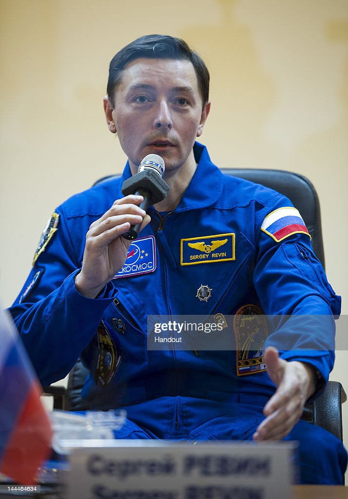 In this handout provided by the National Aeronautics and Space Administration (NASA), quarantined Expedition 31 Flight Engineer Sergei Revin of Russia answers reporters' questions from behind glass during a pre-launch press conference held at the Cosmonaut Hotel on Monday, May 14, 2012 in Baikonur, Kazakhstan. The launch of the Soyuz spacecraft with Expedition 31 crew members Soyuz Commander Gennady Padalka, Flight Engineer Sergei Revin of Russia and prime NASA Flight Engineer Joe Acaba is scheduled for launch at 9:01 a.m. local time on Tuesday, May 15, 2012.