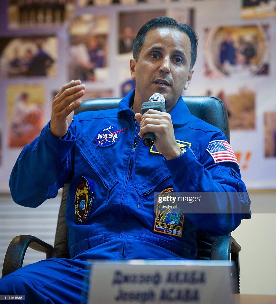 In this handout provided by the National Aeronautics and Space Administration (NASA), quarantined Expedition 31 Flight Engineer Joe Acaba answers reporters' questions from behind glass during a pre-aunch press conference held at the Cosmonaut Hotel on Monday, May 14, 2012 in Baikonur, Kazakhstan. The launch of the Soyuz spacecraft with Expedition 31 crew members Soyuz Commander Gennady Padalka, Flight Engineer Sergei Revin of Russia and prime NASA Flight Engineer Joe Acaba is scheduled for launch at 9:01 a.m. local time on Tuesday, May 15, 2012.