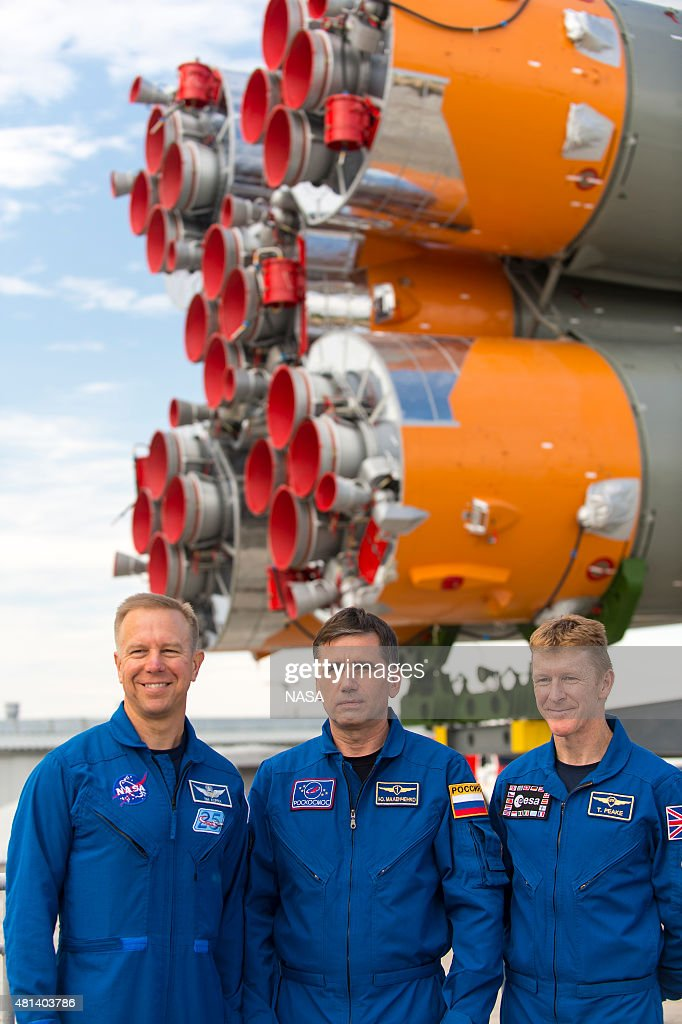 In this handout provided by the National Aeronautics and Space Administration, (L-R) Expedition 44 backup crew members Timothy Kopra of NASA, Yuri Malenchenko of the Russian Federal Space Agency (Roscosmos) and Timothy Peake of the European Space Agency (ESA) pose for a photo as the Soyuz TMA-17M spacecraft is rolled to the launch pad by train on July 20, 2015 at the Baikonur Cosmodrome in Kazakhstan. Launch of the Soyuz rocket is scheduled for July 23 and will carry Expedition 44 Soyuz Commander Oleg Kononenko of the Russian Federal Space Agency (Roscosmos), Flight Engineer Kjell Lindgren of NASA, and Flight Engineer Kimiya Yui of the Japan Aerospace Exploration Agency (JAXA) into orbit to begin their five-month mission on the International Space Station.