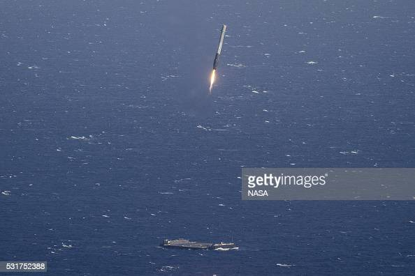 In this handout provided by the National Aeronautics and Space Administration SpaceX's Falcon 9 rocket makes its first successful upright landing on...