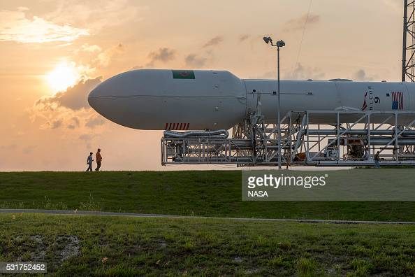 In this handout provided by the National Aeronautics and Space Administration SpaceX's Falcon 9 is moved to the launch pad prior to the rocket's...