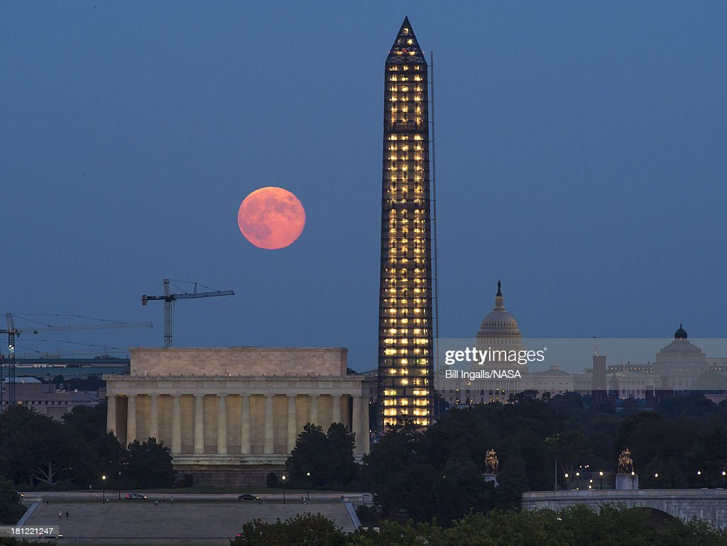 In this handout provided by the National Aeronautics and Space Administration, a full moon, or Harvest Moon, rises over government landmarks Lincoln Memorial, the Capitol buliding and the under-repair Washington Monument September 19, 2013 in Washington, DC.
