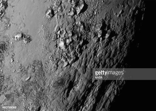 In this handout provided by the National Aeronautics and Space Administration a closeup image of a region near Pluto's equator shows a range of...