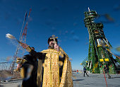 In this handout provided by the National Aeronautics and Space Administration An Orthodox priest blesses members of the media at the Baikonur...