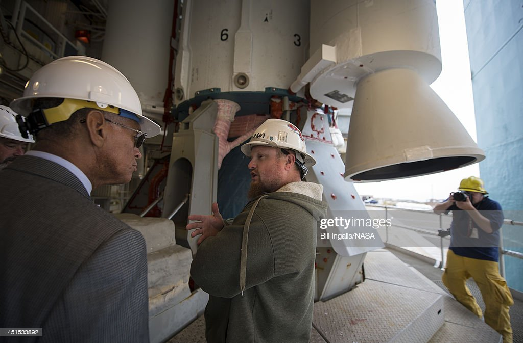 In this handout provided by the National Aeronautics and Space Administration (NASA), NASA Administrator Charles Bolden (L) talks with an engineer at the base of the United Launch Alliance Delta II rocket with the Orbiting Carbon Observatory-2 (OCO-2) satellite onboardat the Space Launch Complex 2 on June 30, 2014 at Vandenberg Air Force Base, California. OCO-2 will measure the global distribution of carbon dioxide, the leading human-produced greenhouse gas believed to drive changes in Earth's climate. OCO-2 is set for a July 1 launch.
