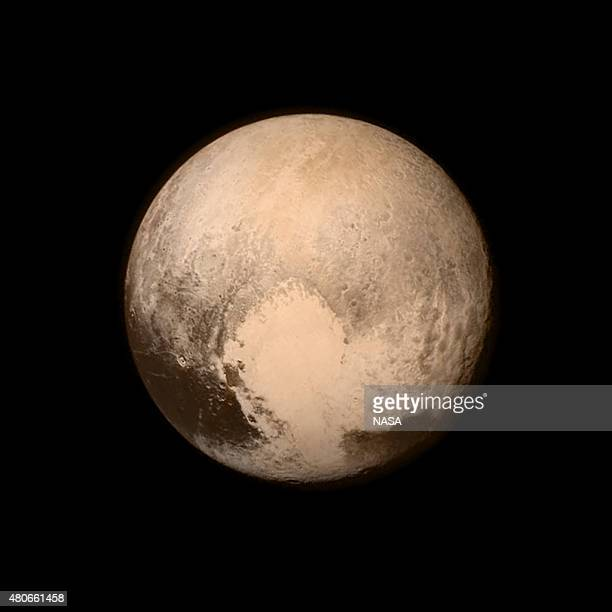In this handout provided by the National Aeronautics and Space Administration Pluto nearly fills the frame in this image from the Long Range...