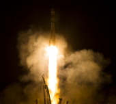 In this handout provided by the National Aeronautics and Space Administration Soyuz TMA13M lifts off from the Russian Baikonour cosmodrome May 28...