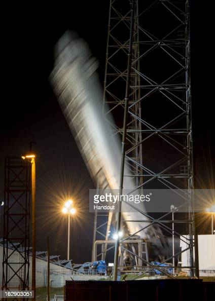 In this handout provided by the National Aeronautics and Space Administration the SpaceX Falcon 9 rocket carrying the Dragon spacecraft onboard is...