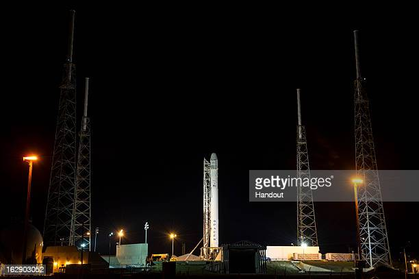 In this handout provided by the National Aeronautics and Space Administration the SpaceX Falcon 9 rocket carrying the Dragon spacecraft onboard sits...