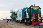 In this handout provided by the National Aeronautics and Space Administration the Soyuz TMA17M spacecraft is rolled out to the launch pad by train on...