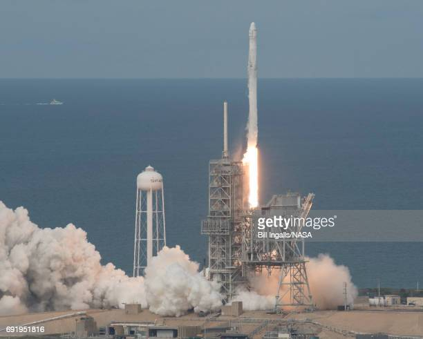 In this handout provided by the National Aeronautics and Space Administration the SpaceX Falcon 9 rocket with the Dragon spacecraft onboard launches...