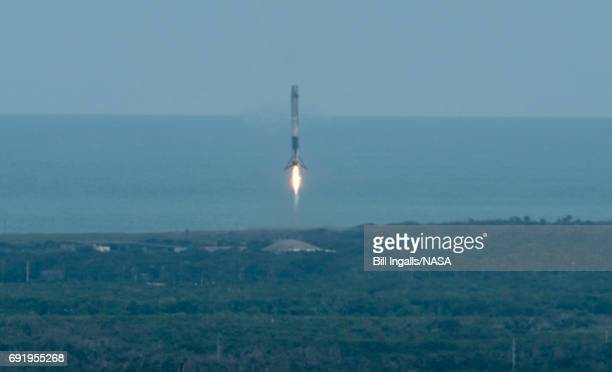 In this handout provided by the National Aeronautics and Space Administration the SpaceX Falcon 9 first stage booster is seen as it lands shortly...