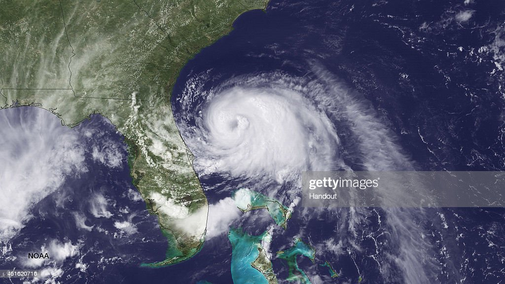 In this handout provided by the National Oceanic and Atmospheric Administration (NOAA) from the GOES-East satellite, Tropical Storm Arthur travels up the east coast of the United States in the Atlantic Ocean pictured at 19:45 UTC/GMT on July 2, 2014. According to reports, Arthur, now with maximum sustaned winds of 70 mph, has begun moving steadily northward is expected to strike the North Carolina Outer Banks over the Fourth of July holiday. Arthur is expected to become a hurricane by July 3.