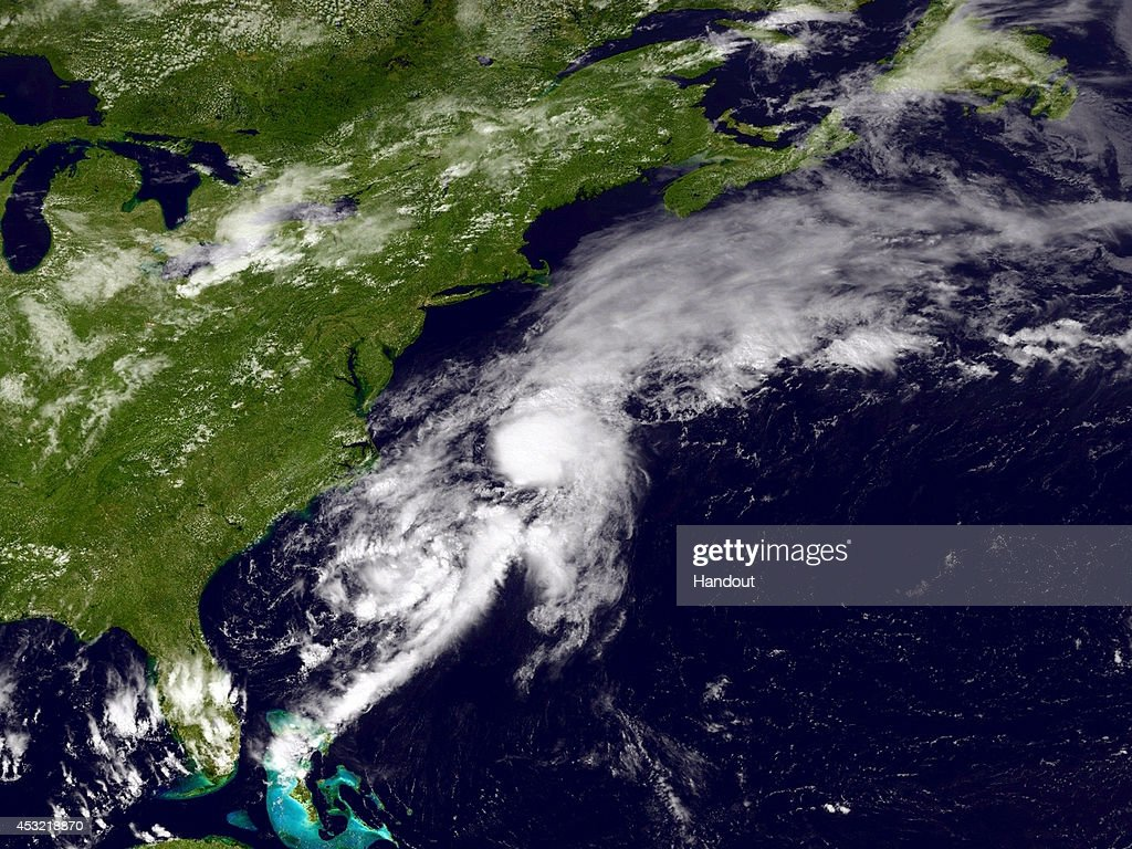 In this handout provided by the National Oceanic and Atmospheric Administration (NOAA) from the GOES-East satellite, a weather system travels up the Atlantic coast of the United States pictured at 17:45 UTC August 5, 2014. The storm named Bertha, the second hurricane of the 2014 Atlantic hurricane season, was downgraded to a tropical storm early Tuesday morning between North Carolina's Outer Banks and Bermuda.