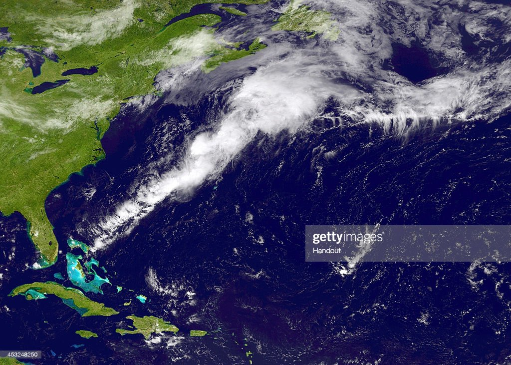 In this handout provided by the National Oceanic and Atmospheric Administration (NOAA) from the GOES-East satellite, a weather system travels north and east in the Atlantic Ocean off the coast of the United States pictured at 17:45 UTC August 6, 2014. The storm named Bertha, the second hurricane of the 2014 Atlantic hurricane season, is now expected to grow in size before becoming a post-tropical cyclone with winds of up to 73mph, possibly reaching Ireland on August 9.