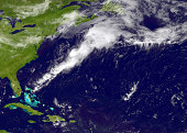 In this handout provided by the National Oceanic and Atmospheric Administration from the GOESEast satellite a weather system travels north and east...