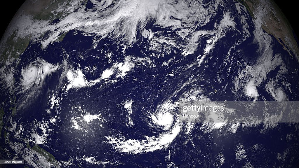In this handout provided by the National Oceanic and Atmospheric Administration (NOAA) from the GOES-East satellite, four separate weather system (L-R) Halong, Genevieve, Iselle, and Julio are tracked in the Pacific Ocean off the west coast of the United States pictured at 0z on August 6, 2014. High pressure from the North is forcing Hurricane Iselle, with top winds of 85 miles and Hurricane Julio, with winds of 75 mph towards the islands of Hawaii.