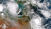 In this handout provided by the National Oceanic and Atmospheric Administration Cyclone Lam in the Arafura Sea and Cyclone Marcia off the east coast...