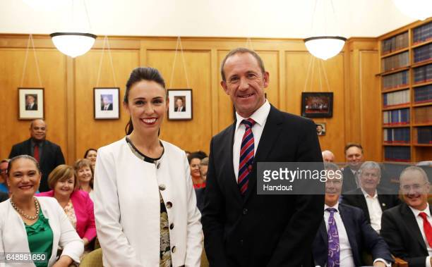 In this handout provided by the New Zealand Labour Party Jacinda Ardern and Andrew Little pose for a photo after Ardern was confirmed as Labour's new...
