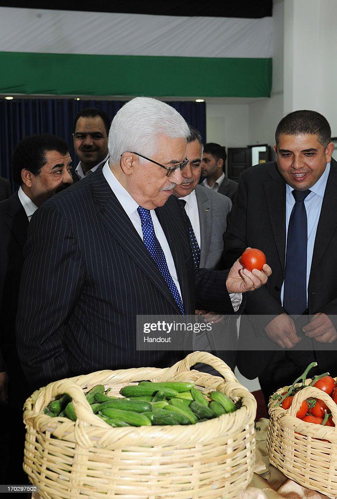 In this handout provided by the Palestinian Presidents Office (PPO) Palestinian President <a gi-track='captionPersonalityLinkClicked' href=/galleries/search?phrase=Mahmoud+Abbas&family=editorial&specificpeople=176534 ng-click='$event.stopPropagation()'>Mahmoud Abbas</a> is shown some vegetables during a display of agricultural products from the Jenin area on June 10, 2013 in Ramallah, West Bank. President Abbas has been discussing opportunities for Palestinian plans to exploit their agriculture, tourism and natural resources in the future despite what he sees as Israeli restrictions on movement of goods and exports.