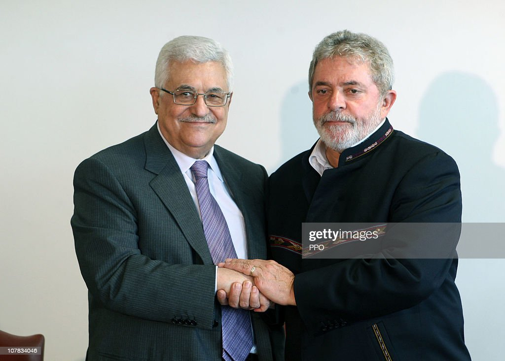 In this handout provided by the Palestinian Press Office, Palestinian President <a gi-track='captionPersonalityLinkClicked' href=/galleries/search?phrase=Mahmoud+Abbas&family=editorial&specificpeople=176534 ng-click='$event.stopPropagation()'>Mahmoud Abbas</a> (L) meets with Brazilian President Luiz Inácio Lula da Silva (R) on December 31, 2010 in Brasilia, Brazil. Abbas Earlier presided over the laying of the foundation stone for a Palestinian embassy, this act is seen as symbolic of a general movement in South America to recognise the Palestinian state. It has however received sharp criticism from the United States lawmakers and Israel. Doves were released during the ceremony to represent peace.