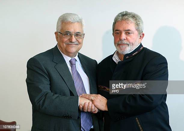 In this handout provided by the Palestinian Press Office Palestinian President Mahmoud Abbas meets with Brazilian President Luiz Inácio Lula da Silva...