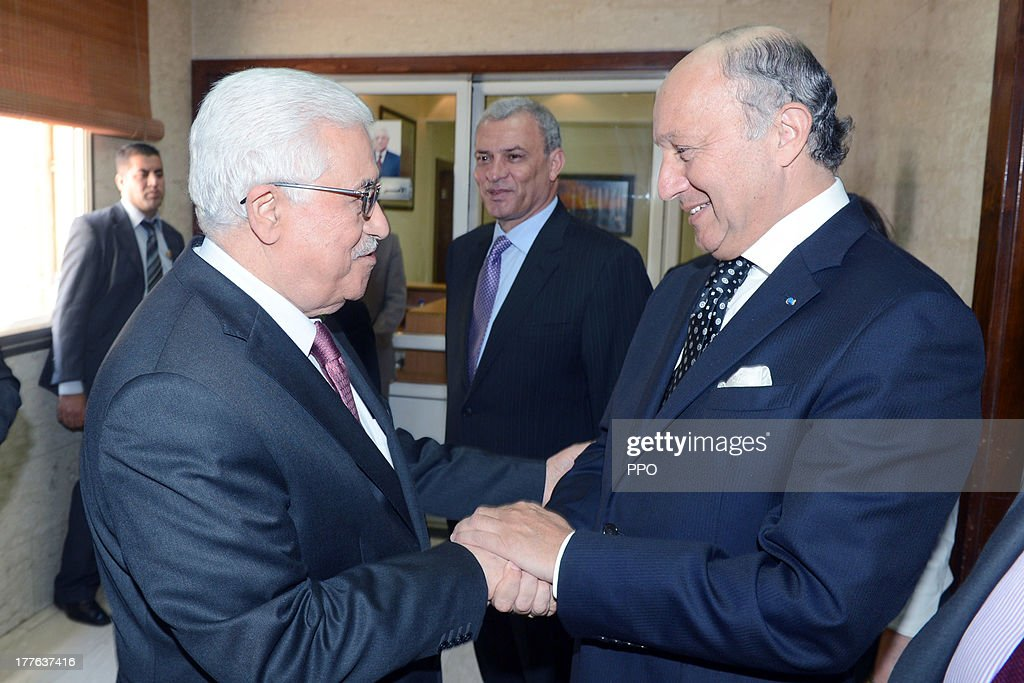 In this handout provided by the PPO, Palestinian President <a gi-track='captionPersonalityLinkClicked' href=/galleries/search?phrase=Mahmoud+Abbas&family=editorial&specificpeople=176534 ng-click='$event.stopPropagation()'>Mahmoud Abbas</a> (R) meets with the Foreign Minister of France <a gi-track='captionPersonalityLinkClicked' href=/galleries/search?phrase=Laurent+Fabius&family=editorial&specificpeople=540660 ng-click='$event.stopPropagation()'>Laurent Fabius</a> August 24, 2013 in Ramallah, West Bank. Israeli and Palestinian negotiators formally resumed direct peace talks earlier this month after a hiatus of nearly three years.