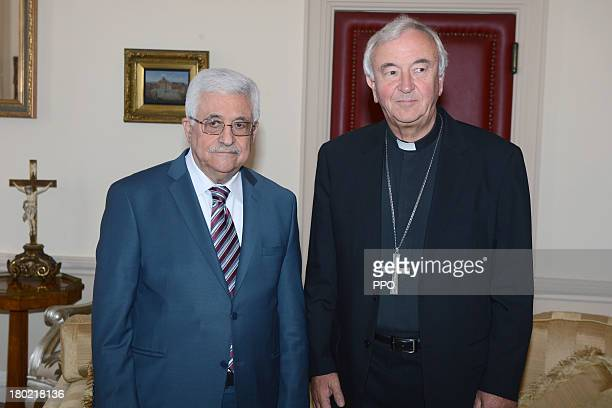 In this handout provided by the PPO President Mahmoud Abbas is greeted by the Archbishop of Westminster Vincent Nichols during a visit to Westminster...