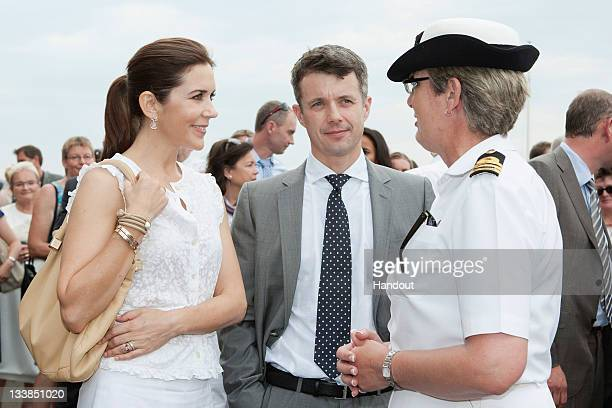 In this handout provided by the Royal Australian Navy Princess Mary of Denmark and Prince Frederik of Denmark speak with the Commanding Officer of...