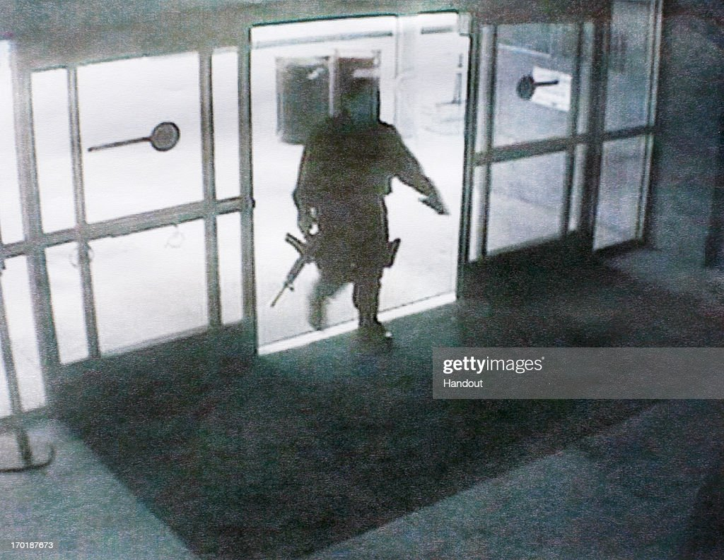 In this handout provided by the Santa Monica Police Department, shows a suspected mass shooting gunman entering the Santa Monica College library during his rampage on June 7, 2013 in Santa Monica, California. The shootings occurred in various locations about three miles south of a political fundraiser attended by President Barack Obama but Secret Service officials said the two events were not related and that the president was never in any danger. Four people besides the gunman have died from their wounds and five others wounded, including a woman who is close to death.