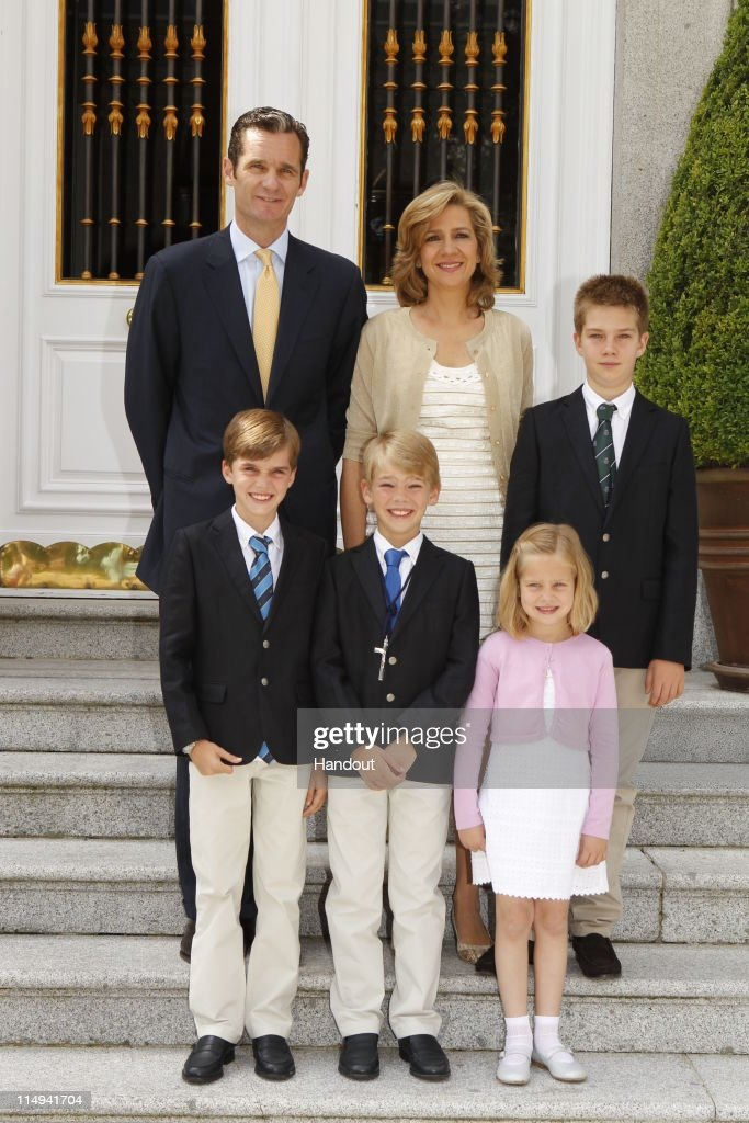 In this handout provided by the Spainish Royal House, Don Miguel Urdangarin y de Borbon, Grande of Spain (Front, Centre) poses with his parents <a gi-track='captionPersonalityLinkClicked' href=/galleries/search?phrase=Princess+Cristina+of+Spain&family=editorial&specificpeople=160232 ng-click='$event.stopPropagation()'>Princess Cristina of Spain</a>, Duchess of Palma de Mallorca (Back, Centre) and <a gi-track='captionPersonalityLinkClicked' href=/galleries/search?phrase=Inaki+Urdangarin&family=editorial&specificpeople=159330 ng-click='$event.stopPropagation()'>Inaki Urdangarin</a>, Duke of Palma de Mallorca, Grandee of Spain (Back, L) and his brothers and sister Don Juan Valentin Urdangarin y de Borbon (Back, L), Don Pablo Nicolas Sebastian Urdangarin y de Borbon (Front, L) and Dona Irene Urdangarin y de Borbon (Front, R) during his First Holy Communion at the Chapel of the Zarzuela Palace on May 28, 2011 in Madrid, Spain. Don Miguel is the third son of The Duke and Duchess of Palma and is currently 10th in the line of succession to the Spanish Throne. Archbishop Juan del Rio officiated the ceremony aided by another priest.