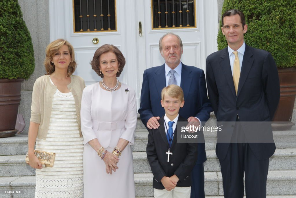 In this handout provided by the Spainish Royal House, King <a gi-track='captionPersonalityLinkClicked' href=/galleries/search?phrase=Juan+Carlos+I&family=editorial&specificpeople=159452 ng-click='$event.stopPropagation()'>Juan Carlos I</a> of Spain (2nd,R) and <a gi-track='captionPersonalityLinkClicked' href=/galleries/search?phrase=Queen+Sofia+of+Spain&family=editorial&specificpeople=160333 ng-click='$event.stopPropagation()'>Queen Sofia of Spain</a> (2nd, L) pose with His Excellency, Don Miguel Urdangarin y de Borbon, Grande of Spain (Front) and his parents <a gi-track='captionPersonalityLinkClicked' href=/galleries/search?phrase=Princess+Cristina+of+Spain&family=editorial&specificpeople=160232 ng-click='$event.stopPropagation()'>Princess Cristina of Spain</a>, Duchess of Palma de Mallorca (L) and <a gi-track='captionPersonalityLinkClicked' href=/galleries/search?phrase=Inaki+Urdangarin&family=editorial&specificpeople=159330 ng-click='$event.stopPropagation()'>Inaki Urdangarin</a>, Duke of Palma de Mallorca, Grandee of Spain (R) during his First Holy Communion at the Chapel of the Zarzuela Palace on May 28, 2011 in Madrid, Spain. Don Miguel is the third son of The Duke and Duchess of Palma and is currently 10th in the line of succession to the Spanish Throne. Archbishop Juan del Rio officiated the ceremony aided by another priest.