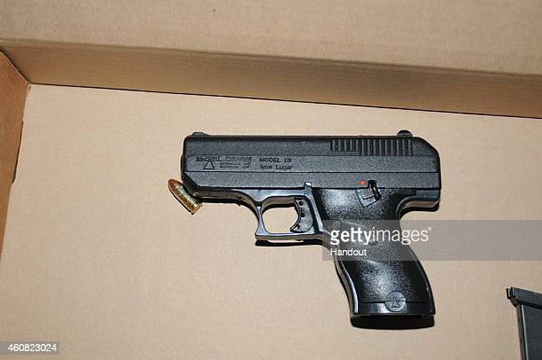 In this handout provided by the St Louis County Police Department a handgun is pictured that was recovered following the officer involved shooting at...
