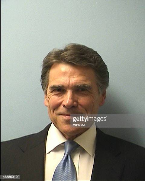 In this handout provided by the Travis County Sheriffs Office Texas Gov Rick Perry poses for a mug shot photo after turning himself in to authorities...
