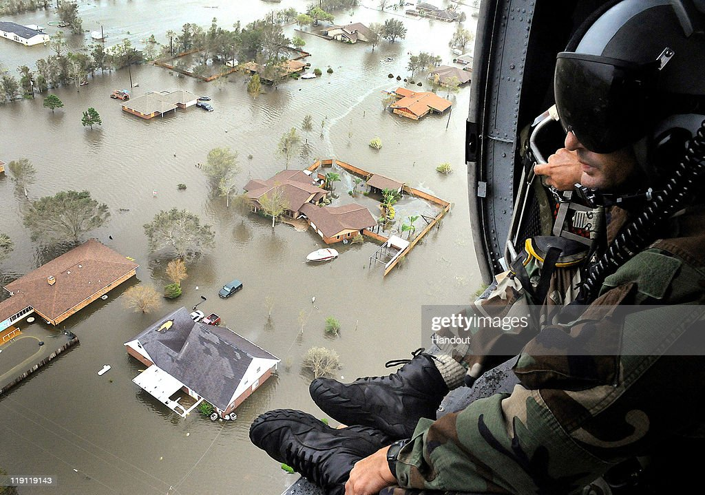 In this handout provided by the U.S. Air Force, an Air Force Reserve pararescueman from the 920th Rescue Wing scans the landscape of Nederland, Texas in the aftermath of Hurricane Ike, 13 September 2008. Deployed with aircrews and aircraft from Patrick Air Force Base, Fla., the pararescuemen rescued 17 people Sept. 13 from the small Texas town.