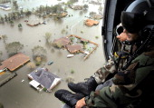 In this handout provided by the US Air Force an Air Force Reserve pararescueman from the 920th Rescue Wing scans the landscape of Nederland Texas in...
