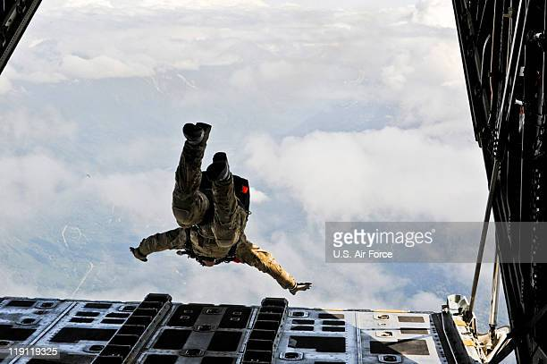 In this handout provided by the US Air Force an Alaska Air National Guard pararescueman performs a highaltitude jump from a Coast Guard C130 Hercules...
