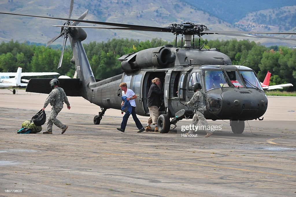In this handout provided by the U.S. National Guard, Colorado Army National Guardsmen from the 2nd Battalion 135th Aviation at Buckley Air Force Base in Aurora, Colo. and civilian rescue personnel unload evacuated residents from Colorado flood zones from a CONG UH-60 Blackhawk helicopter at the Boulder Municipal Airport September 13, 2013 in Boulder, Colorado. Heavy rains for the better part of week fueled widespread flooding in numerous Colorado towns. The historic flooding forced thousands to evacuate the area and more rain is predicted through the weekend.