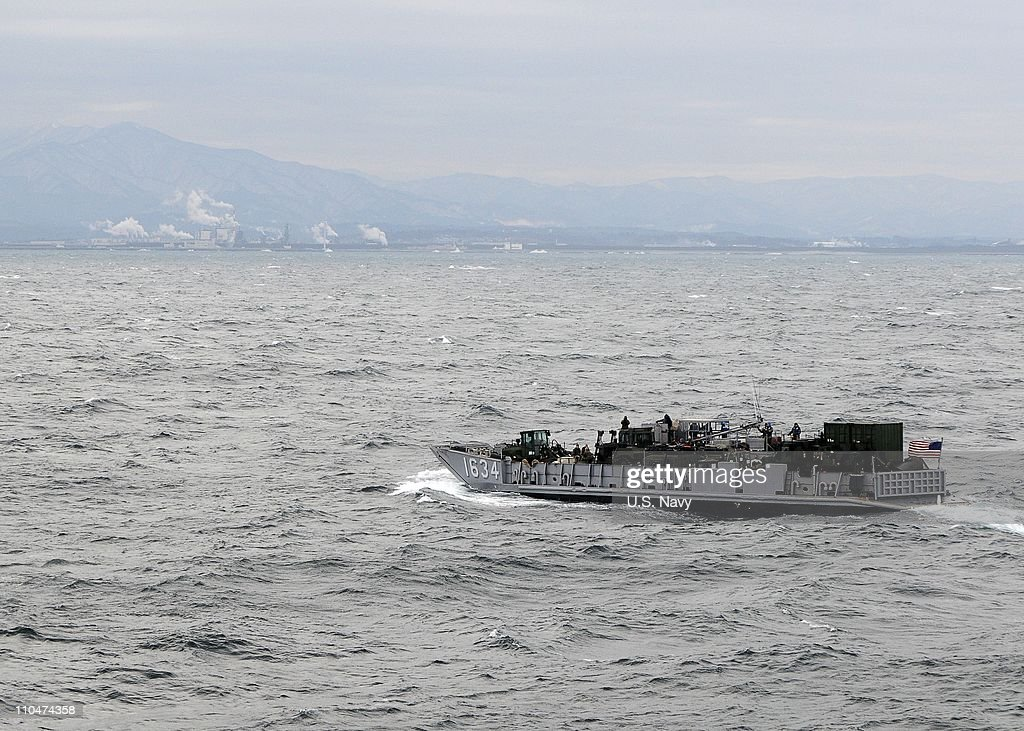 In this handout provided by the U.S. Navy, a landing craft utility debarks the well deck of the forward-deployed amphibious assault ship USS Essex (LHD 2) to survey landing sites near Akita, Japan. The USS Essex, USS Harpers Ferry (LSD 49) and USS Germantown (LSD 42) have arrived off the coast of Japan's Akita prefecture to await further tasking in support of Operation Tomodachi, the US-led disaster relief mission following last week's earthquake and tsunami.