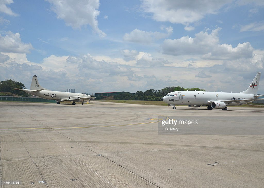 In this handout provided by the U.S. Navy, A P-3C Orion, left, assigned to Patrol Squadron (VP) 46 taxis by a P-8A Poseidon assigned to Patrol Squadron 16 before its mission to assist in search and rescue operations for Malaysia Airlines flight MH370 on March 17, 2014 in Kuala Lumpur, Malaysia. VP-16 and VP-46 are deployed in the U.S. 7th Fleet area of responsibility supporting security and stability in the Indo-Asia-Pacific region. The missing aircraft disappeared one week ago carrying 227 passengers and 12 crew, baffling the international rescue and search teams who have found no remains or clues in the waters surrounding South East Asia. All passengers and crew are currently under investigation for possible sabotage although no evidence of such activity has been found.